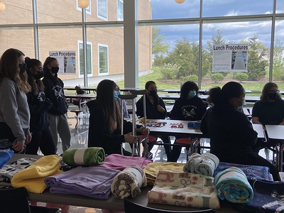 innovation-softball-team-handcrafts-fleece-blankets-for-patients-at-hospital-for-special-care