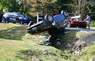 car-leaves-road-in-southington-falls-down-embankment