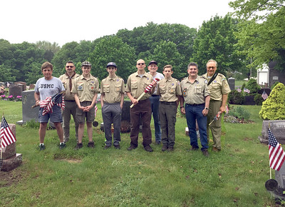 local-boy-scouts-place-flags-on-veterans-graves
