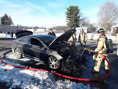 driver-passenger-bolt-from-car-after-engine-bursts-into-flames