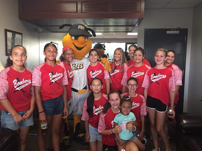 softball-fans-young-players-crowd-new-britain-stadium-for-battle-of-the-sexes-exhibition