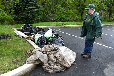 conservation-committee-members-clean-up-riverbank-in-plainville