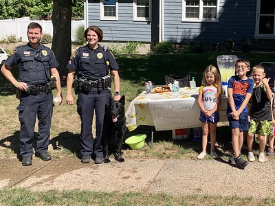 the-kids-were-so-excited-6yearold-twins-from-berlin-donate-money-from-lemonade-stand-to-police-departments-canine-unit-receive-special-coins