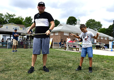 residents-enjoy-free-food-and-learn-how-they-can-help-their-neighborhood-at-the-east-side-community-barbecue