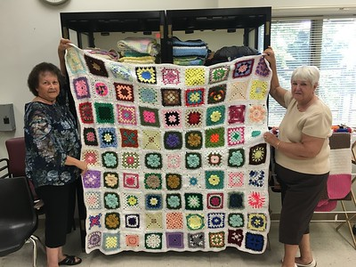 woman-crafts-coverlet-from-with-81-squares-from-national-knit-exchange