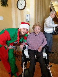visitors-come-bearing-christmas-gifts-for-seniors-at-newington-nursing-home