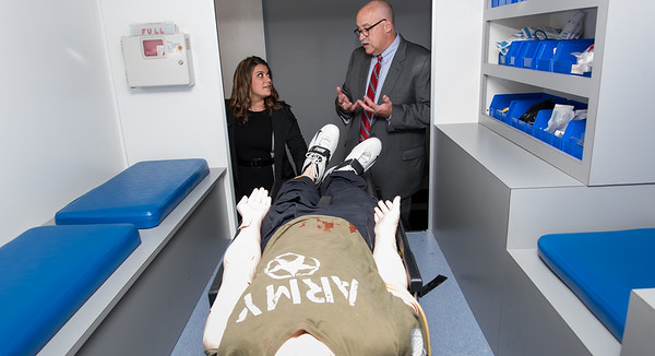 Wesley Bunnell | Staff Mayor Erin Stewart listens as New Britain EMS CEO Bruce Baxter explains the ambulance simulation room Tuesday afternoon.