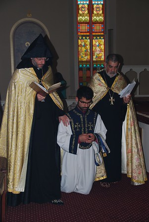 Courtesy photo | Sponsoring priests, the then V. Rev. Fr. Daniel Findikyan, (now Bishop and Primate of the eastern Diocese of the Armenian Church) and Rev. Fr. Krikor Sabounjian, bringing the then Sub Deacon Michael Sabounjian to the altar for his diaconate ordination on November 2, 2014.
