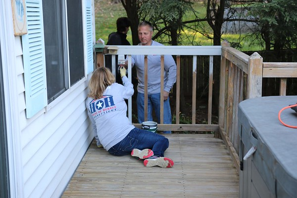 Courtesy of Dennis Buden House of Heroes Connecticut volunteers paint the porch of Marine Corps veteran Walter Radziszewski's New Britain home Saturday.
