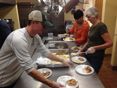 caring-is-sharing-salvation-army-volunteers-serve-thanksgiving-meals-to-needy