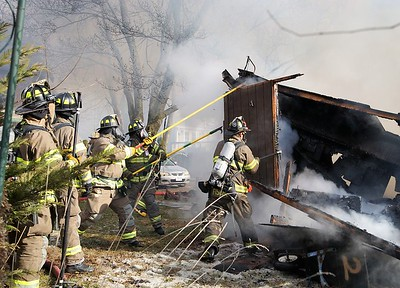 fire-destroys-garage-in-newington