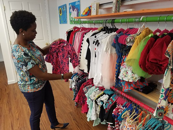 Charles Paullin | Staff Davina Ismail, owner of DribbleBabies, shows off  some girls outfits at her store, at 53 Columbus Blvd.
