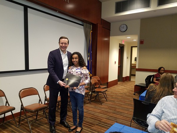 New Britain Herald  Pizzas On Murphy For Top King Essayists Chris Murphy Hands A Certificate To New Britain Student Aliya Parker Viera  In Recognition Of Her Winning Essay