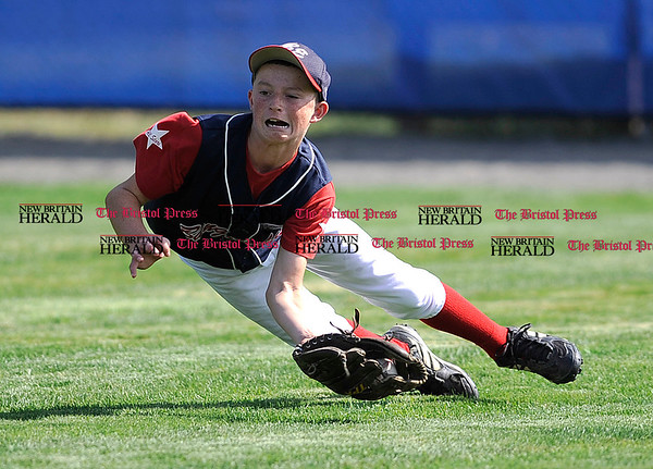 8/6/2010 Mike Orazzi | Staff Maine's Ethan Dorman (4) makes a diving catch in center field during game two at the 2010 Eastern Regional Little League Tournament in Bristol on Friday, August 6, 2010. Maine beat Massachusetts 6-4.