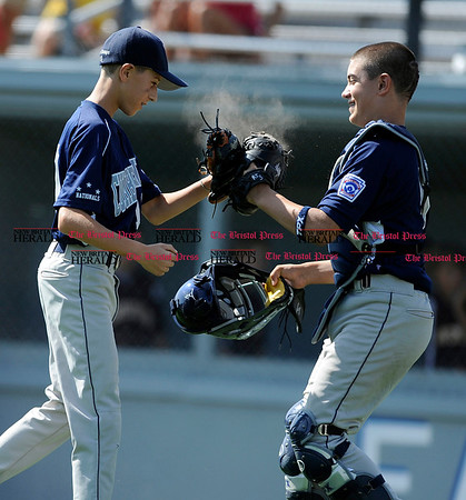 8/7/2010 Mike Orazzi | Staff Rhode Island's Dante Baldelli (10) and Justin D'Abrosca (5) celebrate after an 8-6 win over New Hampshire in the 2010 Eastern Regional Little League Tournament in Bristol on Saturday.