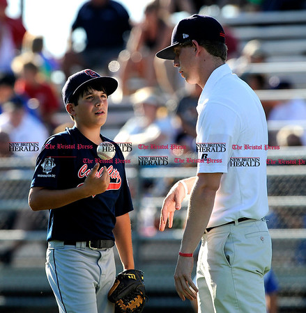 8/7/2010 Mike Orazzi | Staff DC's Alex Conte (1) talks with of one of the coaches during a 10-0 loss to New York during the 2010 Eastern Regional Little League Tournament in Bristol.