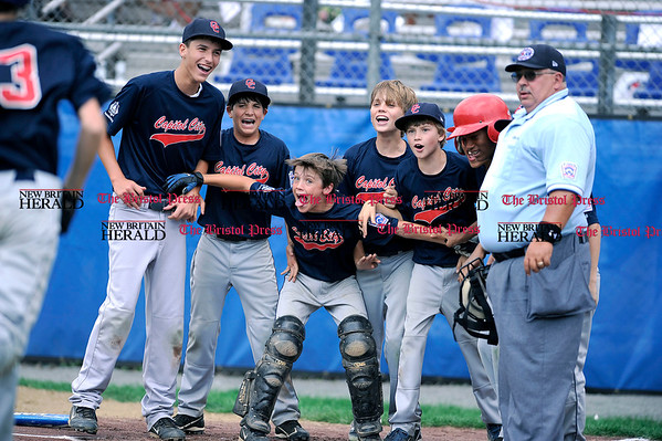8/6/2010 Mike Orazzi | Staff District of Columbia players wait for David Orem (13) after his home run in the first game of the 2010 Eastern Regional Little League Tournament in Bristol on Friday, August 6, 2010. DC lost 7-5 to Maryland.