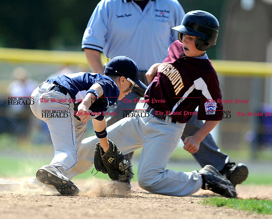 8/7/2010 Mike Orazzi | Staff Rhode Island's Josh Brodeur (11) tags Daniel Philbrick (11) out at second during an 8-6 win over New Hampshire in the 2010 Eastern Regional Little League Tournament in Bristol on Saturday.