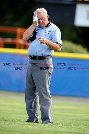8/9/2010 Mike Orazzi | Staff First base umpire William Stuart wipes off sweat during a 14-1 Maryland loss to Pennsylvania in the game 14 of the 2010 Eastern Region Little League Tournament in Bristol on Monday afternoon.