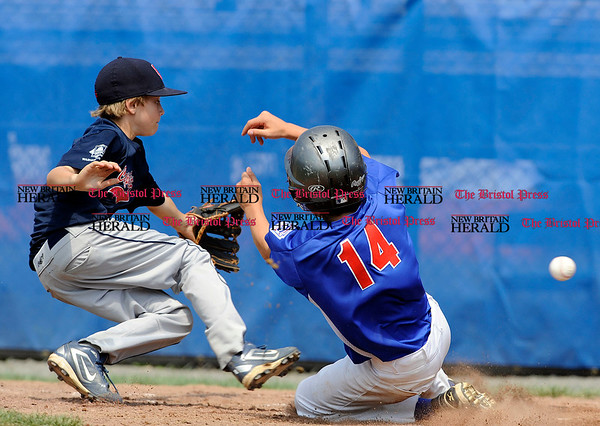 8/9/2010 Mike Orazzi | Staff The District of Columbia's Cooper Jensen (14 waits for the ball as New Jersey's Patrick Marinaccio (14) score during a 21-0 DC loss to New Jersey during game 13 of the 2010 Eastern Regional Little League Tournament in Bristol on Monday.