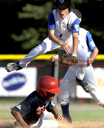 8/7/2010 Mike Orazzi | Staff New York's Billy Rotella (4) starts a double play with DC's Aaron Hansford (18) in a 10-0 NY win during the 2010 Eastern Regional Little League Tournament in Bristol.