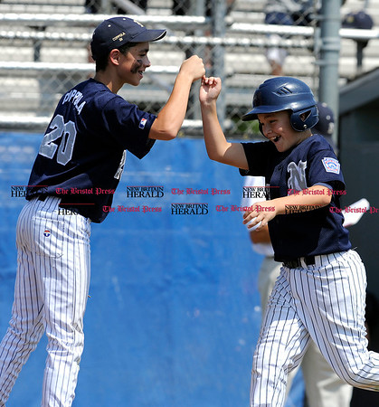 8/9/2010 Mike Orazzi | Staff Pennsylvania's John Coppola (20) and Zac Deegan (3) after Deegan's his home run during a 14-1 MD loss to Pennsylvania in the game 14 of the 2010 Eastern Region Little League Tournament in Bristol on Monday afternoon.