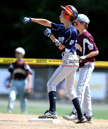 8/7/2010 Mike Orazzi | Staff Rhode Island's Mike Bogolowski (12) celebrates an RBI during an 8-6 win over New Hampshire in the 2010 Eastern Regional Little League Tournament in Bristol on Saturday.