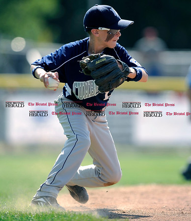 8/7/2010 Mike Orazzi | Staff Rhode Island's Josh Brodeur (11) field a ground ball during an 8-6 win over New Hampshire in the 2010 Eastern Regional Little League Tournament in Bristol on Saturday.