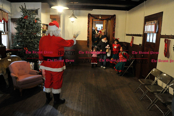 Rob Heyl Santa greets his young guests. 12.11..10 for 12.12.10