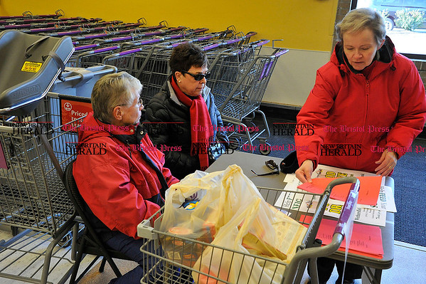 Rob Heyl Collecting food for the Wethersfield Food Bank is the ladies from The General Federation of Woman's Clubs Newington / Wethersfield Chapter (L) Maureen Realt , Veronika Westbrook and Mary Young. The were collecting at the Shop Rite in Wethersfield next to Jordan Lane. 12.11.10 for 12.12..10