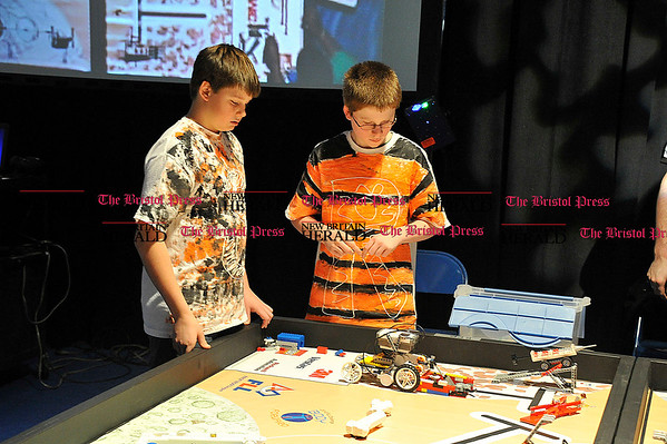 Rob Heyl The &quote;STRIPES&quote; team from St. Thomas Southington have (L) Jamison Baker 12 and Jamison Keith 12 controling the robot. 12.12.10 for 12.13.10