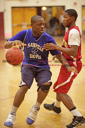 Chris Richie | Staff Plainville's Kreyshon Schuler with the ball during the 25th annual Lion's Club charity basketball tournament. (12/10/10)