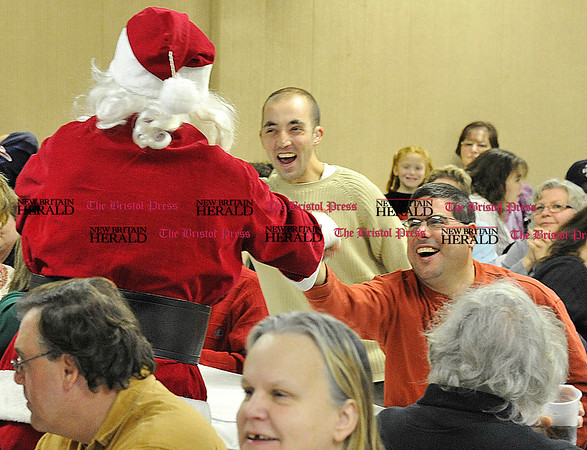 Rob Heyl John Davis and Roger Bartholomeu both from Bristol are happy to see Santa. 12.12.10 for 12.13.10