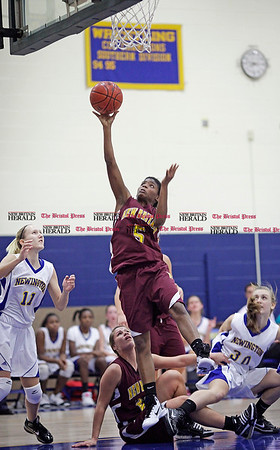 Chris Richie | Staff Nyjah Porcher puts up a shot during the New Britain girls basketball game at Newington. (12/10/10)