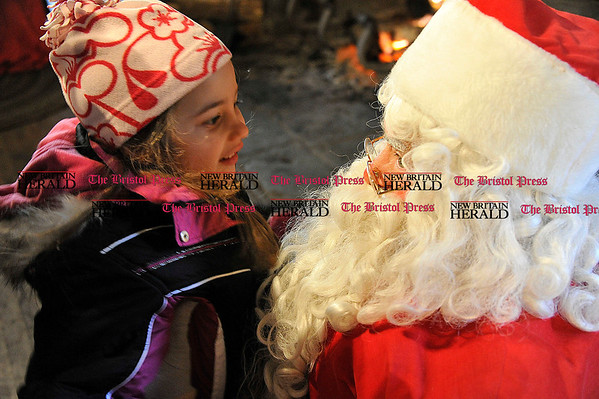 Rob Heyl Samantha Bartucca 5 from Bristol meets Santa. 12.11.10 for 12.12.10