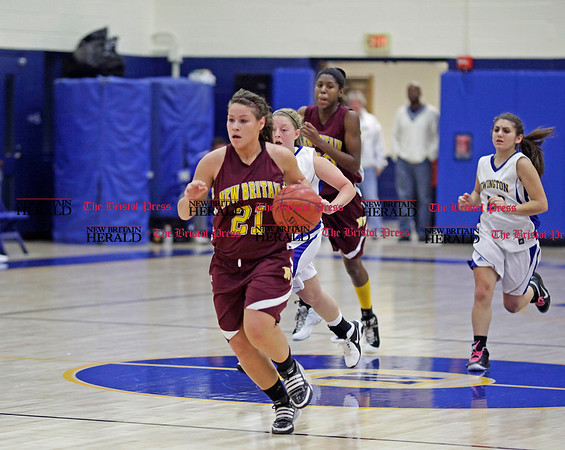 Chris Richie | Staff Jaydelise Yambo drives down the court during the New Britain girls basketball game at Newington. (12/10/10)
