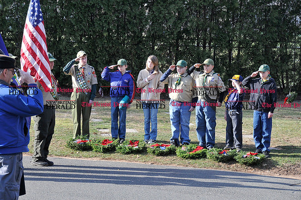 Derek Stanton Boy Scouts from Troop 347 and a Girl Scout from Troop 10536 give Honor prior to placing wreaths. 12.11.10 for 12.12.10