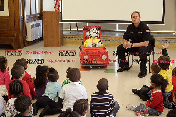 Chris Richie | Staff New Britain firefighter John Golebiewski teaches fire safety with Patches the robot at the Ben Franklin Early Childcare Learning Academy in New Britain. (12/14/10)