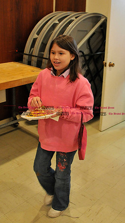 Rob Heyl Kayana Vega 9 from New Britain is ready to sample the cookies she made. 12.11.10 for 12.12.10