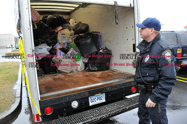 Rob Heyl Officer Fenn shows off the toys donated so far. He wants to over fill the truck. 12.12.10 for 12.13.10