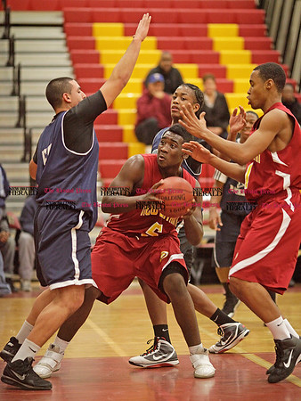 Chris Richie | Staff New Britain's Craven Johnson with the ball during the 25th annual Lion's Club charity basketball tournament. (12/10/10)