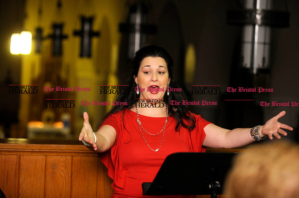 11/9/2010 Mike Orazzi | Staff Christina Micari works with members of the St. Stanislaus Church Choir on Tuesday night.