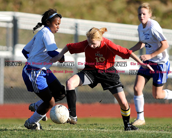 11/11/2010 Mike Orazzi | Staff Bristol Eastern's Alexa Pearson (9) and New Canaan's Caroline Murray (10) during the Class L Second Round Soccer Tournament at Bristol Eastern High School on Thursday afternoon.