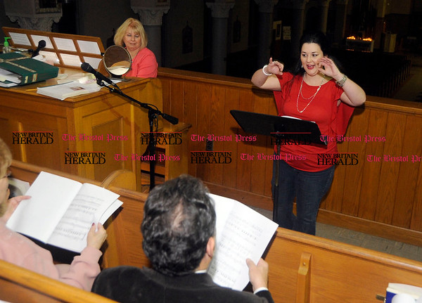 11/9/2010 Mike Orazzi | Staff Christina Micari works with members of the St. Stanislaus Church Choir on Tuesday evening.