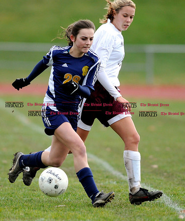 11/9/2010 Mike Orazzi | Staff Simsbury's Meredith Miller (28) and Bristol Central's Jessica Markure (14) in a Class LL First Round Soccer match at Bristol Central on Tuesday afternoon.