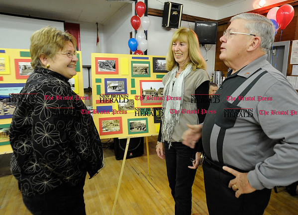 11/6/2010 Mike Orazzi | Staff Linda Jasinksi (left) and Rick and Gail Leach (right) look at photographs of Bristol during the Bristol Stomp, part of the city's 225 anniversary celebration held at the Polish American Club in Bristol on Saturday night.