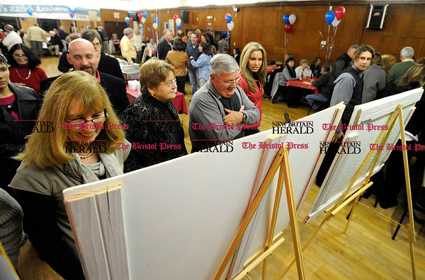 11/6/2010 Mike Orazzi | Staff Gail Leach (left), Linda Jasinksi and Rick Leach (right) look at photographs of Bristol during the Bristol Stomp, part of the city's 225 anniversary celebration held at the Polish American Club in Bristol on Saturday night.