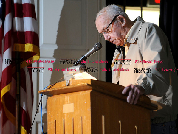 11/11/2010 Mike Orazzi | Staff WWII veteran John Lasnier reads the names of fallen WWII veterans during the Veterans Day ceremony at the Memorial Blvd. School in Bristol on Thursday morning.