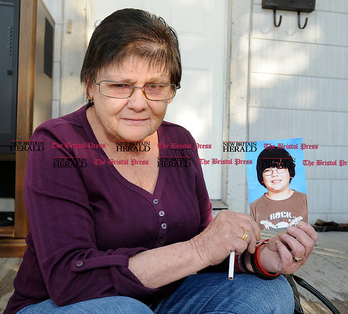 11/3/2010 Mike Orazzi | Staff Arlene Waye holds a photo of her grandson Henry Waye Jr.