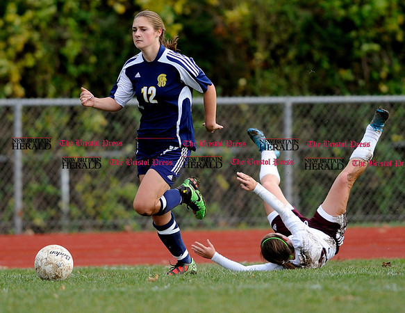 11/9/2010 Mike Orazzi | Staff Simsbury's Meagan Hallworth (12) trips up and Bristol Central's Elise Galipo (22) in a Class LL First Round Soccer match at Bristol Central on Tuesday afternoon.